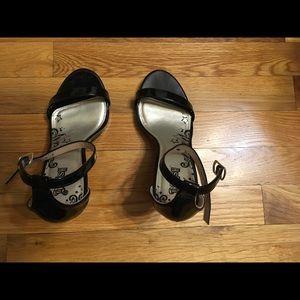 Black faux patent leather heels (shoes)